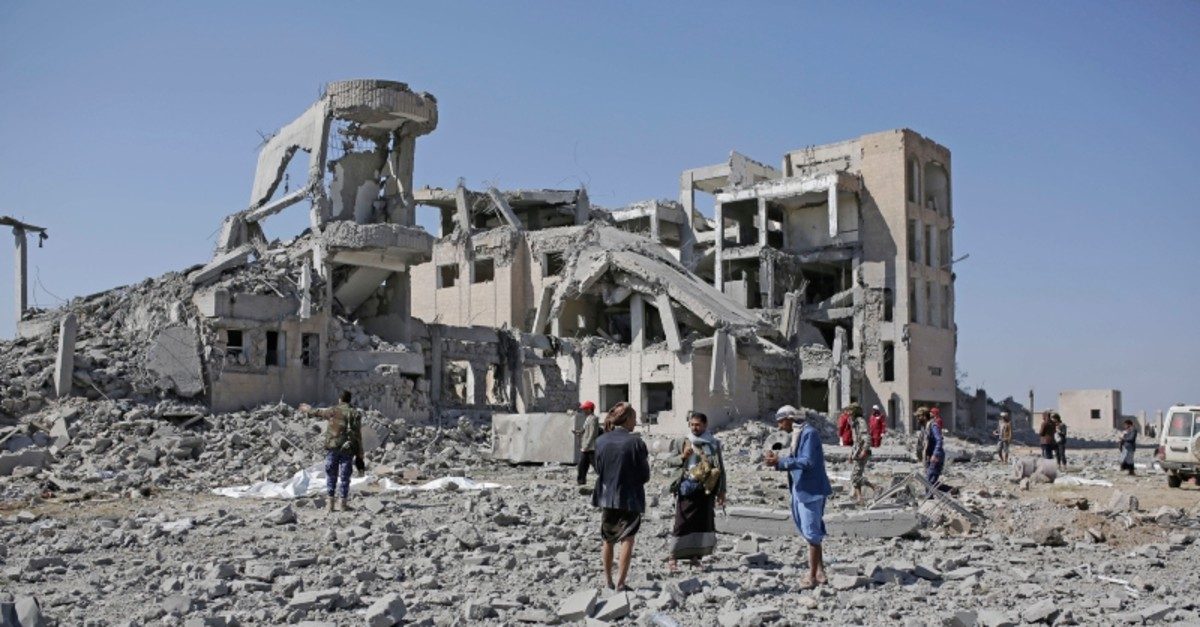 Bodies covered in plastic lie on the ground amid the rubble of a Houthi detention center destroyed by Saudi-led airstrikes, that reportedly killed dozens, in Dhamar province, southwestern Yemen, Sept. 1, 2019. (AP Photo)