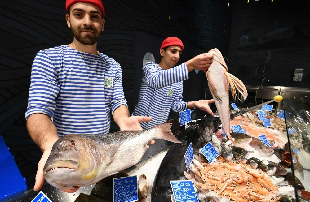 Fishmongers present Mediterranean fish at a stand during a press tour at FICO Eataly World agri-food park in Bologna.