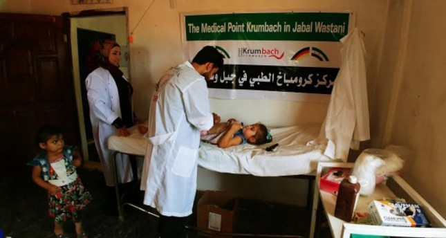 """Adnan Wahhoud has seven """"medical points"""" in the northwestern Syrian province of Idlib. These medical care centers offer free medical treatment and medication."""