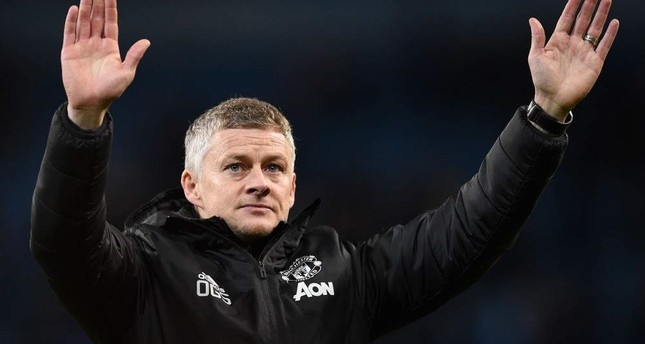 Ole Gunnar Solskjaer applauds the fans following the English League Cup semi-final second leg football match, Manchester, Jan. 29, 2020. AFP Photo