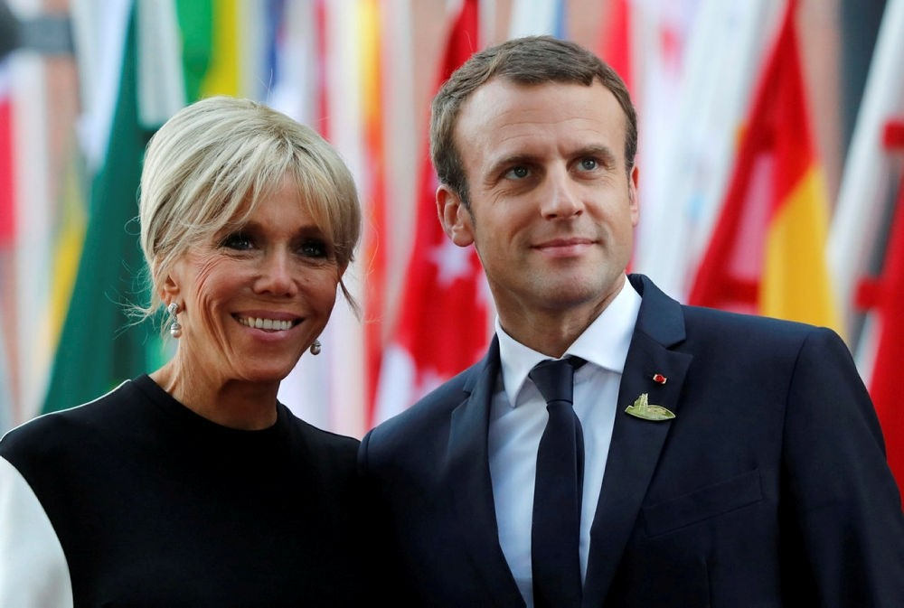 French President Emmanuel Macron and hiw wife Brigitte Macron are seen July 7, 2017 at the G20 summit in Hamburg, Germany.   Picture taken July 7, 2017. (Reuters Photo)