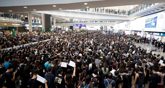Protesters demonstrate at the airport in Hong Kong, Monday, Aug. 12, 2019. (AP Photo)