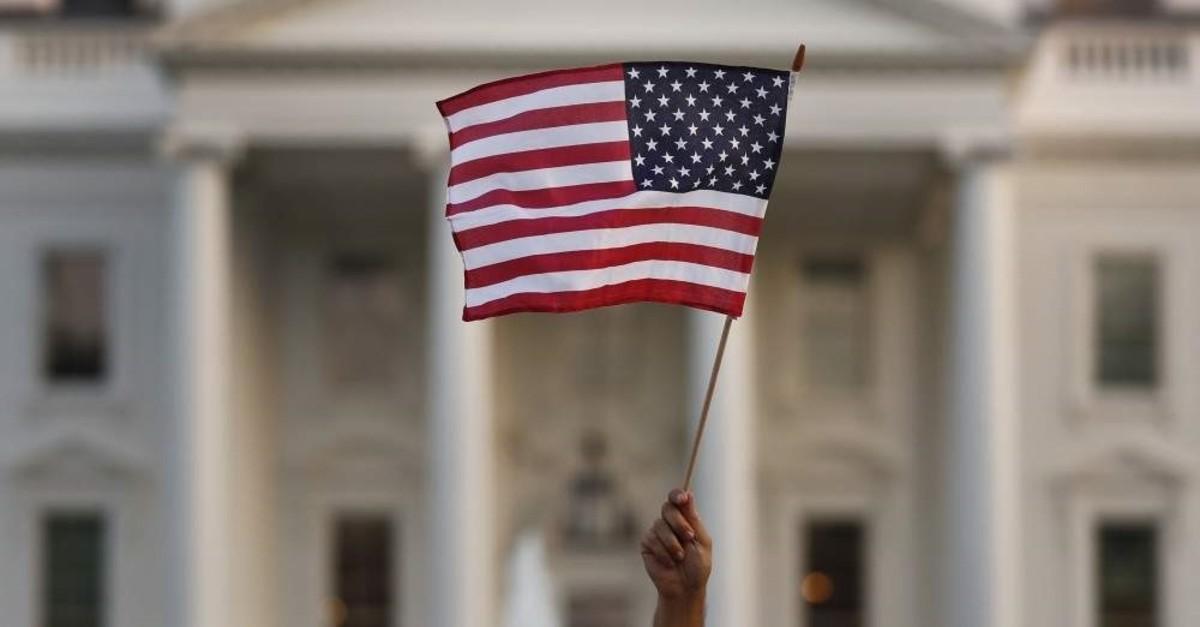 A flag is waved outside the White House, Washington, September 2017. (AP Photo)