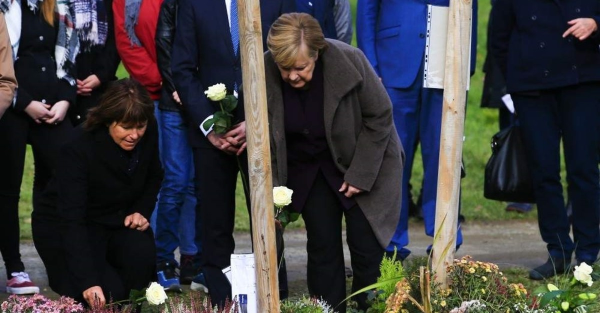German Chancellor Angela Merkel visits the commemoration park made in the honor of Turks killed by the NSU, Nov. 4, 2019.