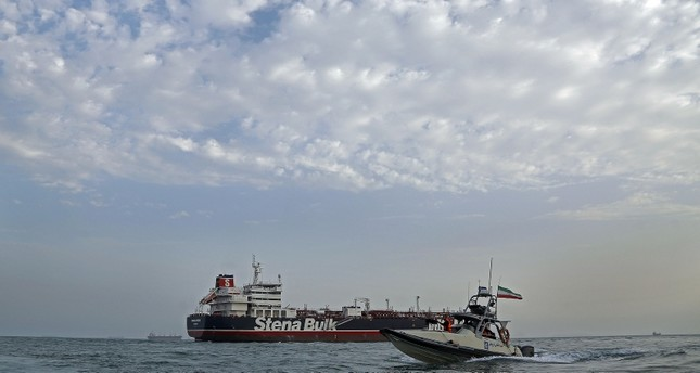 A picture taken on July 21, 2019, shows Iranian Revolutionary Guards patrolling around the British-flagged tanker Stena Impero as it's anchored off the Iranian port city of Bandar Abbas. AFP Photo
