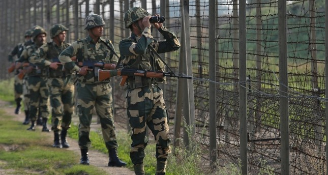 India's Border Security Force (BSF) soldiers patrol along the fenced border with Pakistan in Ranbir Singh Pura sector near Jammu, Feb. 26, 2019. (Reuters Photo)
