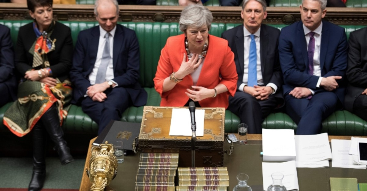 A handout photograph released by the UK Parliament shows Britain's Prime Minister Theresa May speaking at the start of the debate on the second meaningful vote on the government's Brexit deal, in the House of Commons in London on March 12, 2019. (AP)