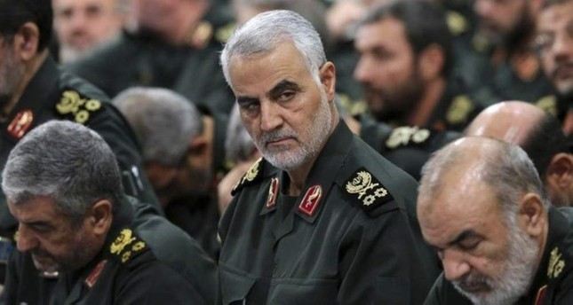 In this Sept. 18, 2016, file photo provided by an official website of the office of the Iranian supreme leader, Gen. Qassem Soleimani C attends a meeting in Tehran, Iran. AP Photo