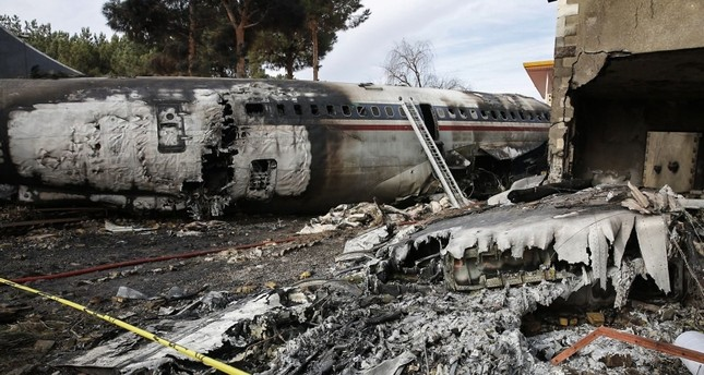 A picture taken on January 14, 2019 shows a Boeing 707 cargo plane that reportedly crashed into a residential complex near the Iranian capital Tehran with 10 people onboard (AFP Photo)