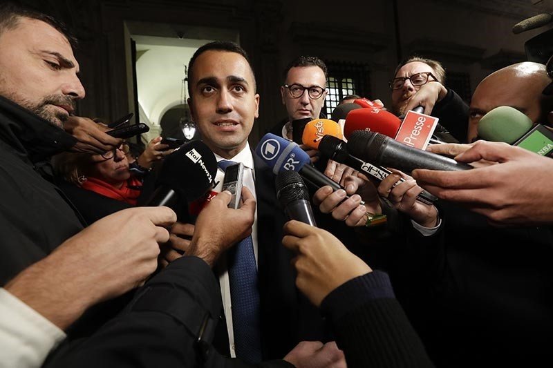 Italian deputy Premier and Labor Minister Luigi Di Maio talks to reporters at the end of a cabinet meeting on Italy's budget, outside Rome's Chigi Palace government headquarters, Tuesday, Nov. 13, 2018. (AP Photo)