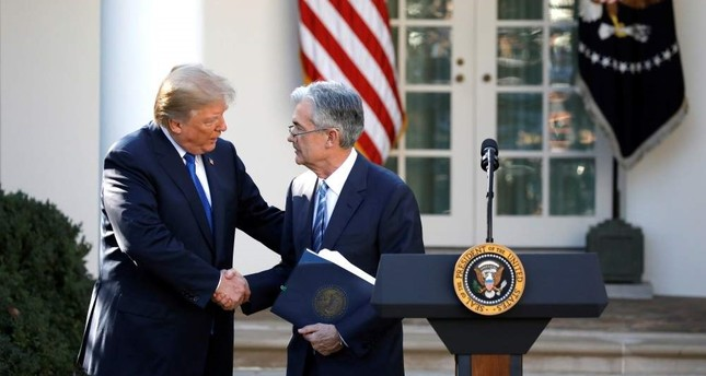 In this file photo, U.S. President Donald Trump shakes hands with Jerome Powell, then his nominee to become chairman of the U.S. Federal Reserve at the White House, Washington, U.S., Nov. 2, 2017.