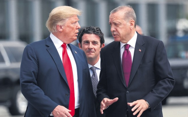 President Recep Tayyip Erdoğan and U.S. President Donald Trump (L) gesture as they talk at the start of the NATO summit, Brussels, Belgium, July 11, 2018.