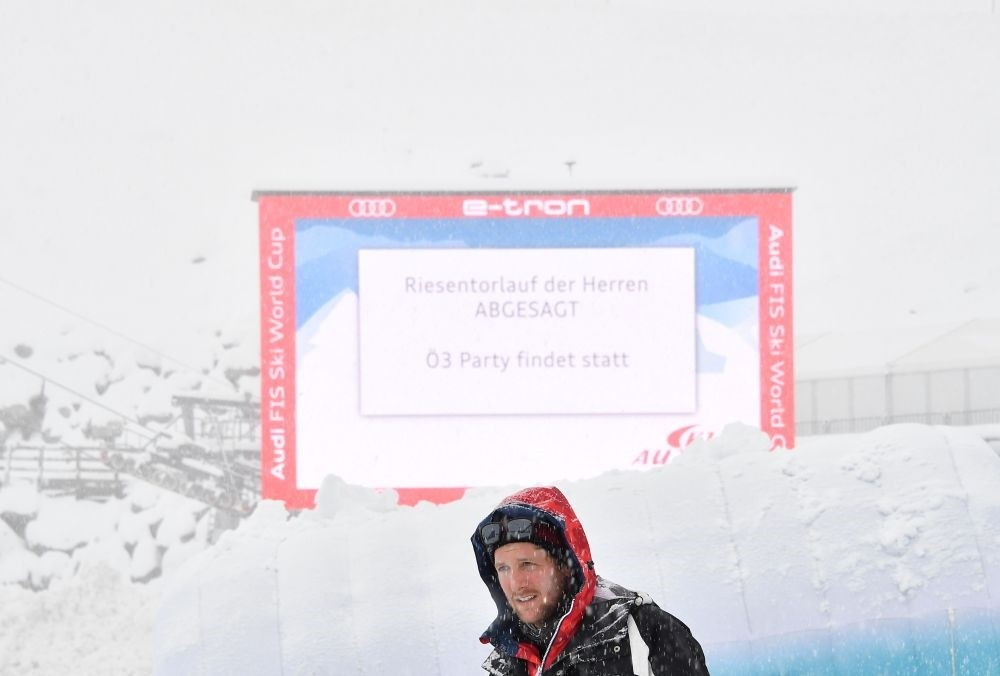 A large display announces the cancellation of the men's giant slalom competition due to heavy snowfall and strong winds during the FIS Alpine Ski World Cup on Oct. 28, Soelden, Austria.