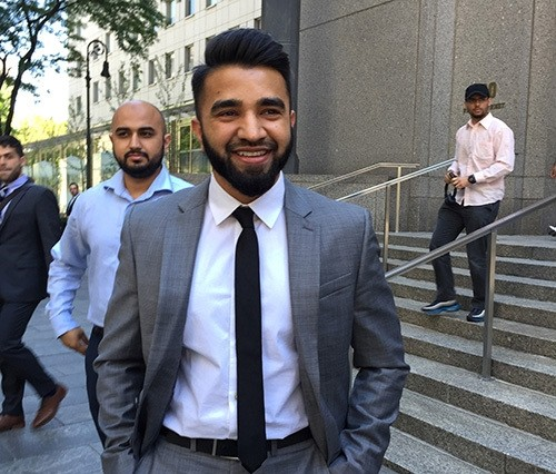 New York Police Department Officer Masood Syed, a practicing Muslim, center, smiles as he leaves Manhattan federal court in New York Wednesday, June 22, 2016 (AP Photo)