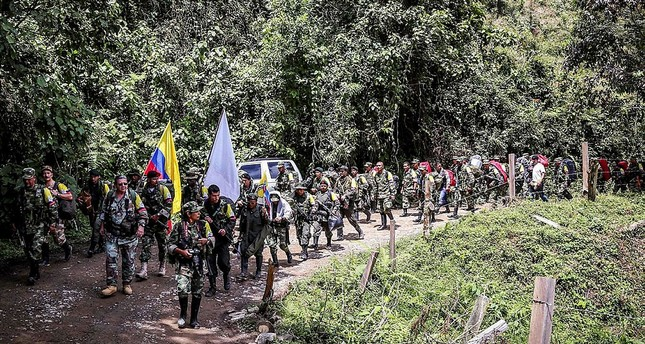 Commander Pablo Catatumbo leading a guerrillas column arriving to hand on their weapons in Buenos Aires, Cauca department, Colombia on January 1, 2017. (AFP Photo)