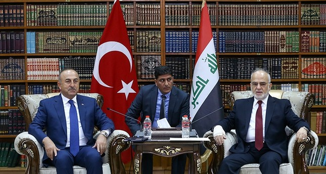 Foreign Minister Mevlüt Çavuşoğlu (Left) with Iraqi counterpart Ibrahim Jafari at a meeting in Baghdad, August 23, 2017 (AA Photo)