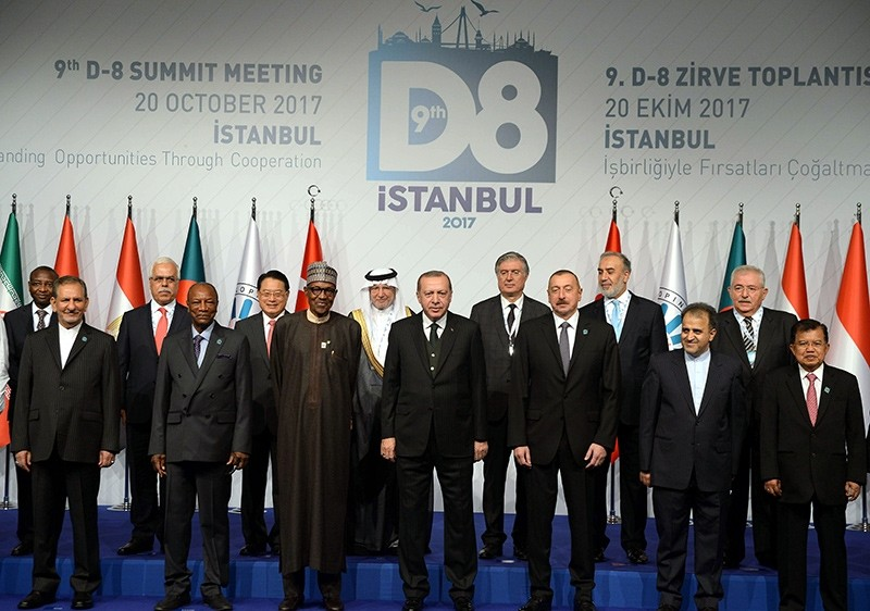 President Erdou011fan (center) posing for a group photo with leaders attending the D-8 Summit in Istanbul, Oct. 20, 2017 (DHA Photo)