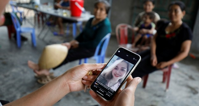 A relative looks at an image of Anna Bui Thi Nhung, a Vietnamese suspected victim in a truck container in UK, at her home in Nghe An province, Vietnam Oct. 26, 2019 (Reuters Photo)