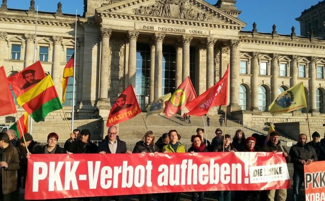 Pro-PKK supporters seen holding a banner that reads Lift the PKK ban during a demonstration in front of the Reichstag building in Berlin to show solidarity with the terrorist group