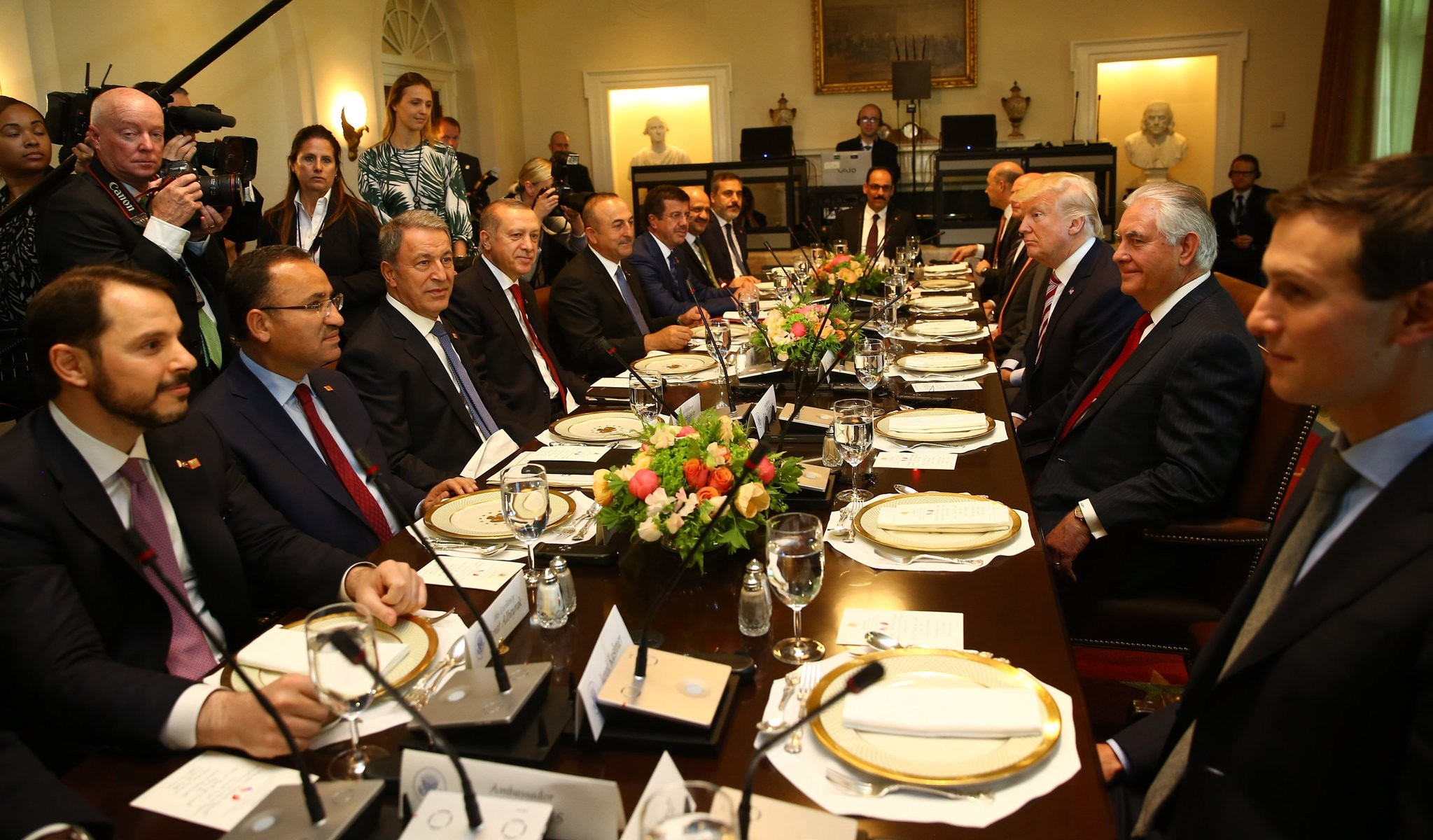 President Erdou011fan, U.S. President Trump and their delegations prepare to have lunch before a meeting on bilateral relations and mutual cooperation on regional issues, in the Cabinet Room of the White House, May 16.