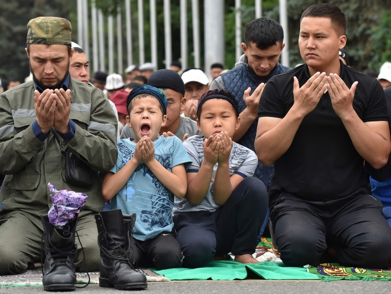 Kyrgyz Muslims pray in the central of Bishkek