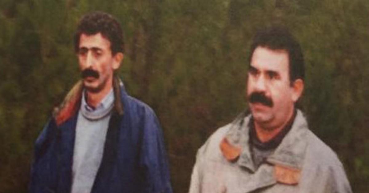 In this undated file photo, senior PKK figure Ru0131za Altun, left, walks next to the terror groupu2019s leader Abdullah u00d6calan. (AA Photo)