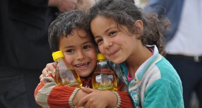 الإغاثة الإنسانية التركية توزع طروداً غذائية لـ 30 ألف طفل يتيم في 40 بلد