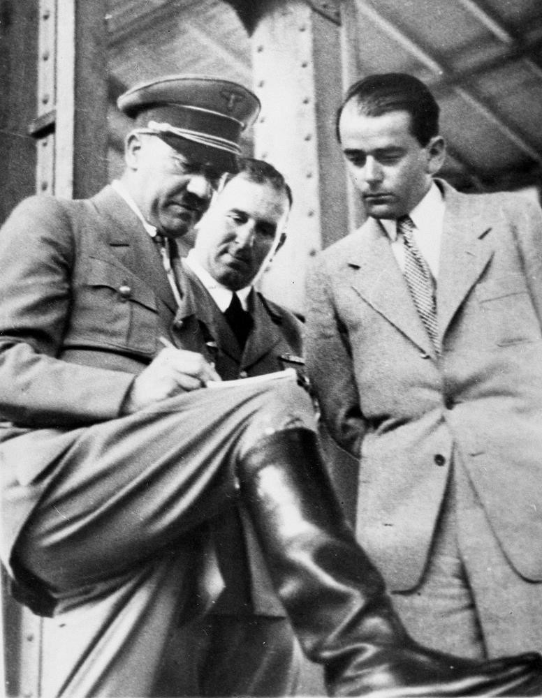 Adolf Hitler, (L), discusses plans for building a convention hall at Nuremberg with Lord Mayor Willy Liebel, (C), and Professor Albert Speer, (R), at Nuremberg, Germany.