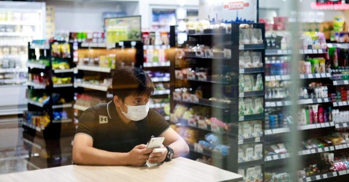 A man wearing a mask sits in a convenience store in Paranaque, Metro Manila, Philippines, Jan. 30, 2020. (Reuters Photo)