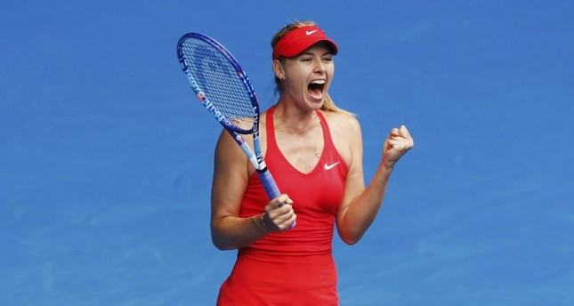 Maria Sharapova celebrates after defeating Eugenie Bouchard of Canada in their women's singles quarter-final match at the Australian Open 2015 tennis tournament in Melbourne.