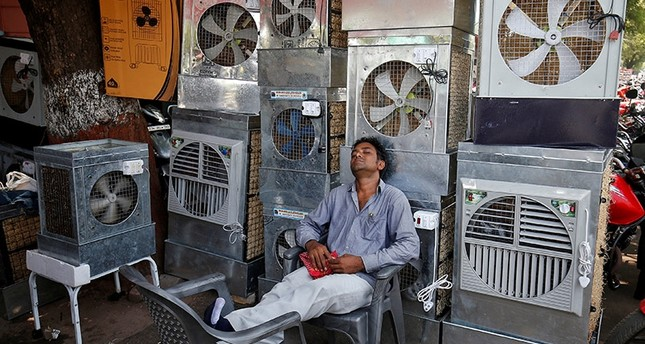 A man selling air coolers rests at a market on a hot summer day in Ahmedabad, India May 4, 2017 Reuters Photo