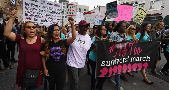 Victims of sexual harassment, sexual assault, sexual abuse and their supporters protest during a #MeToo march in Hollywood, California on Nov 12, 2017. (AFP Photo)