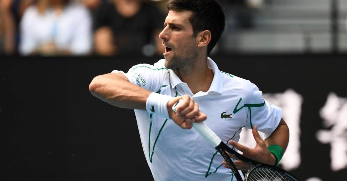 Djokovic hits a forehand to Schwartzman at the Australian Open in Melbourne, Jan. 26, 2020.