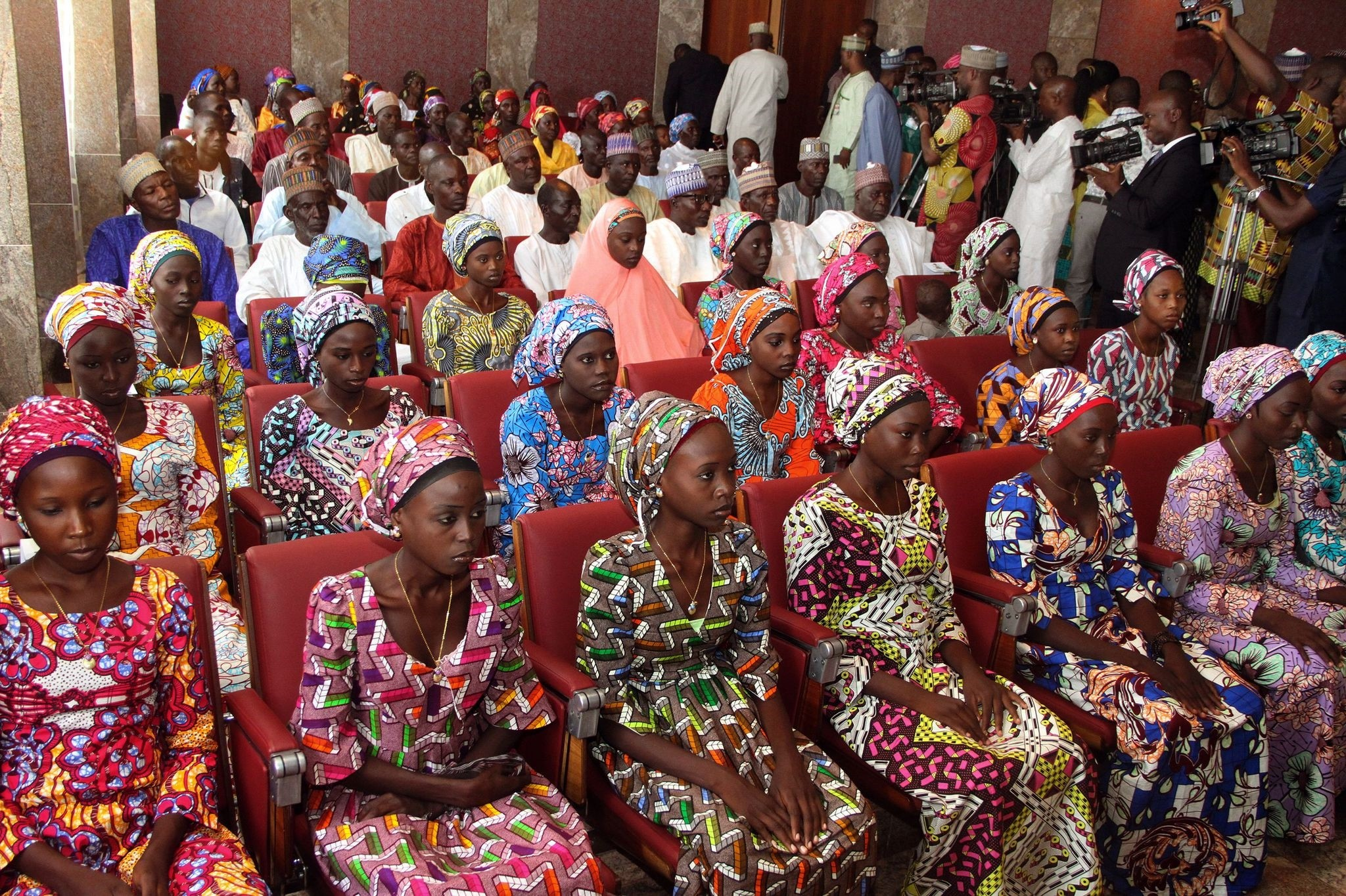The photo taken on October 19, 2016 shows 21 Chibok girls who were released by Boko Haram a week before, attending a meeting with the Nigerian President. (AFP Photo)