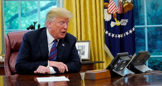 U.S. President Donald Trump speaks to Mexican President Enrique Pena Nieto on the phone as he makes an announcement on status of NAFTA from the Oval Office of the White House in Washington, U.S., Aug. 27, 2018. (Reuters Photo)