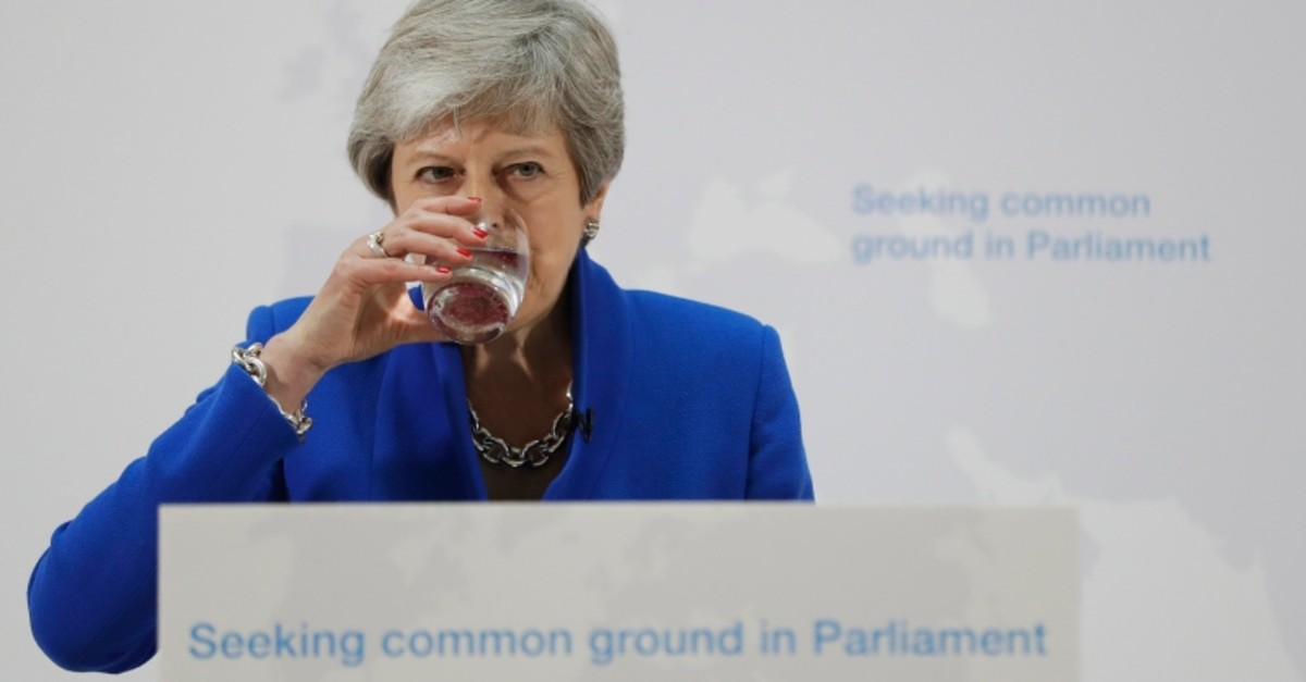 Britain's Prime Minister Theresa May drinks water during a speech in London, Tuesday, May 21, 2019. (AP Photo)