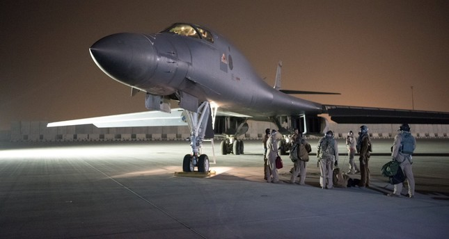 A U.S. Air Force B-1B Lancer and crew, being deployed to launch a strike as part of the multinational response to Syria's use of chemical weapons, is seen at Al Udeid Air Base, Doha, Qatar, April 14.