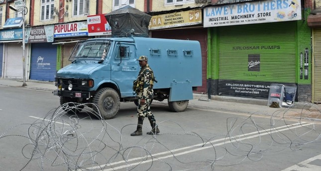 A member of the Indian security forces stands guard during a lockdown in Srinagar on August 16, 2019, after the Indian government stripped Jammu and Kashmir of its autonomy. (AFP Photo)