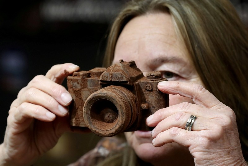 A photo camera made of chocolate is seen at the