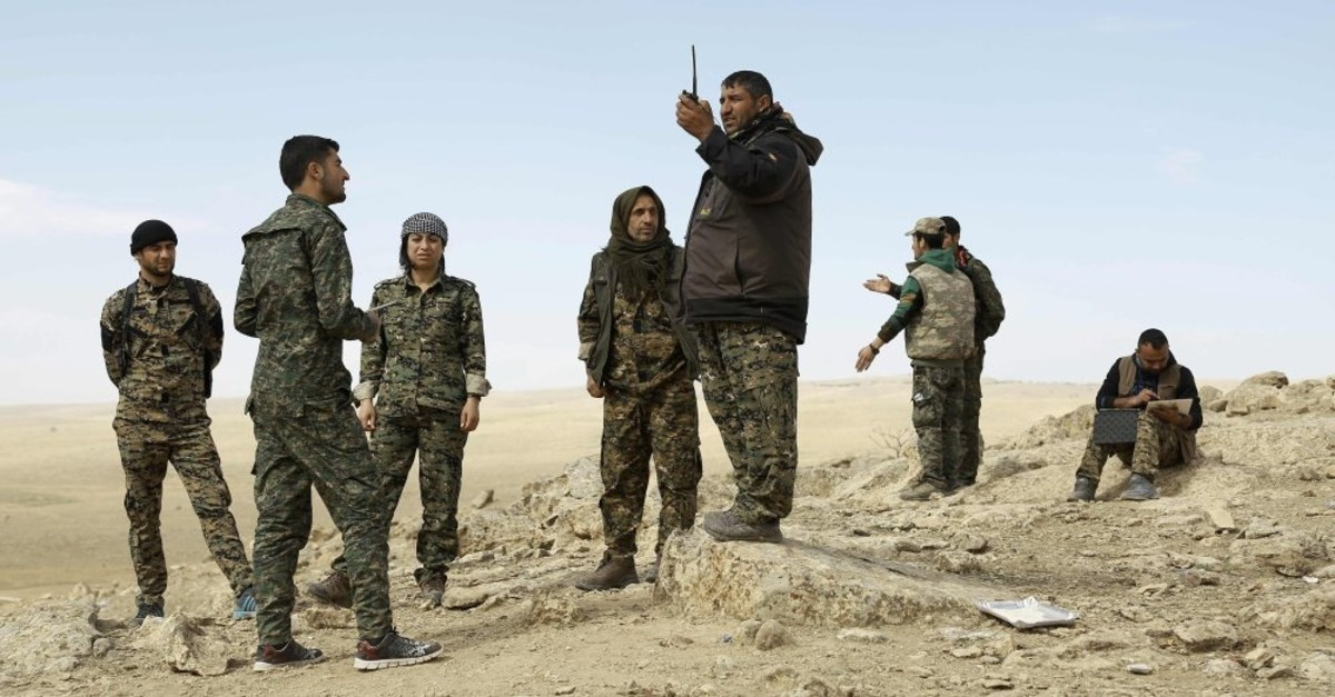 Members of the YPG-dominated SDF listen to instructions as they stand on the outskirts of the town of Chaddade in the northeastern Syrian province of Hasakah, Feb. 19, 2016.