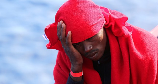 A migrant rests on the Vos Hestia ship after being rescued by the Save the Children NGO crew in the Mediterranean sea off the Libya coast, June 19, 2017. (REUTERS Photo)