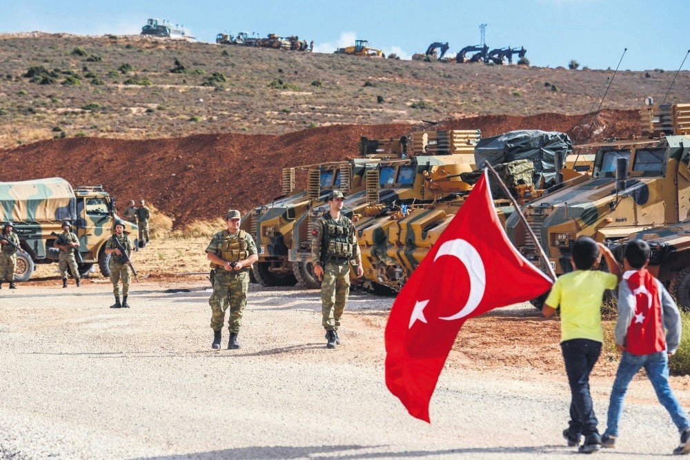 Young boys carry a Turkish flag during a demonstration in support of the Turkish military's operation in Idlib near the Turkish-Syrian border in a bid to create a de-escalation zone, Oct. 10, 2017.