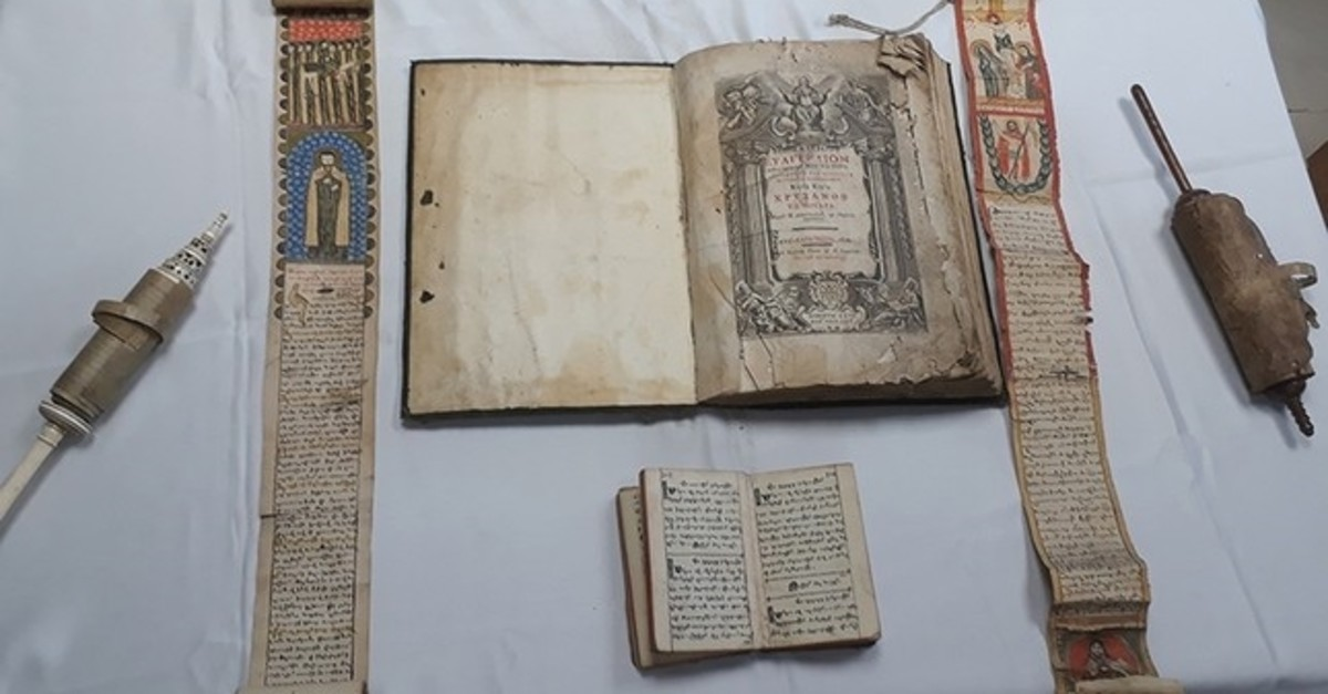 An ancient manuscript seized in an anti-smuggling operation in Istanbul in March displayed to reporters, March 28, 2019.