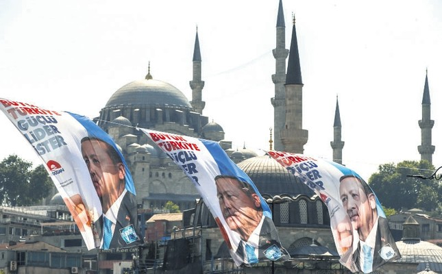 Election posters of President Recep Tayyip Erdoğan and his ruling Justice and Development Party (AK Party) decorate a street in İstanbul, June 6.