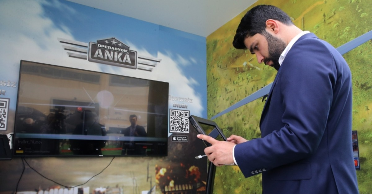 A man plays the mobile app game ,Operation: Anka, at the International Defense Industry Fair (IDEF'19) in Istanbul on May 2, 2019. (AA Photo)