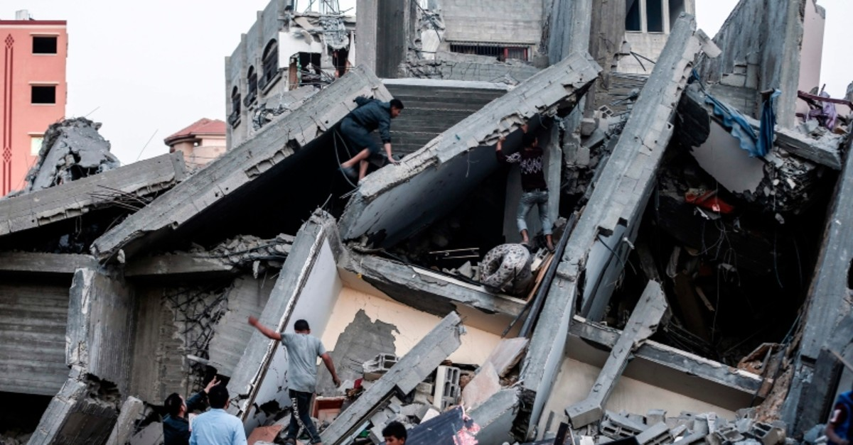 A picture taken on May 5, 2019, shows the remains of a building in Gaza City after it was hit during Israeli airstrikes. (AFP Photo)