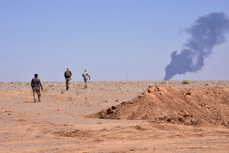 Smoke billows as Assad regime forces advance in Al-Shula on the southwestern outskirts of Deir el-Zour on September 8, 2017, during the ongoing battle against Daesh terrorists. (AFP Photo)