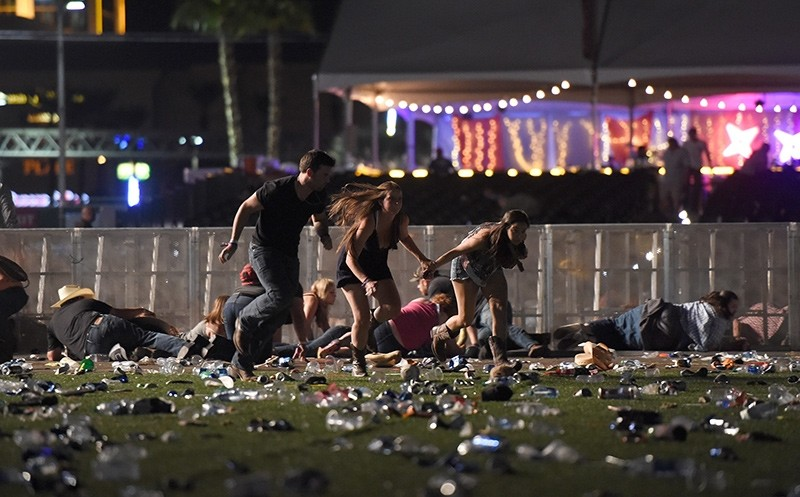People run from the Route 91 Harvest country music festival after apparent gun fire was heard on October 1, 2017 in Las Vegas, Nevada (AFP Photo)
