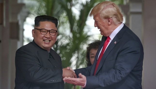 . S. President Donald Trump shakes hands with North Korea leader Kim Jong Un at the Capella resort on Sentosa Island Tuesday, June 12, 2018 in Singapore. (AP Photo)