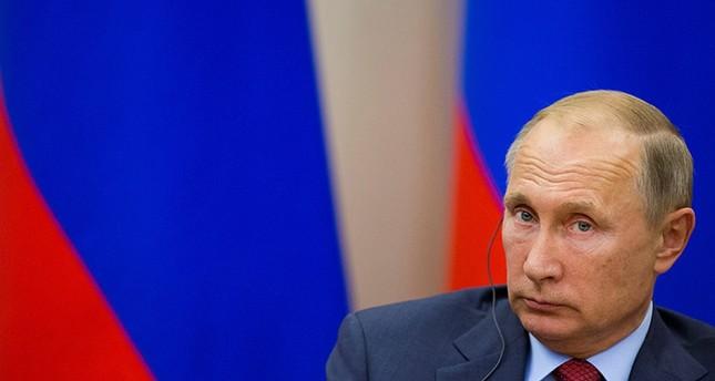 Russian President Vladimir Putin attends a joint news conference with Croatian President Kolinda Grabar-Kitarovic ( Reuters Photo)